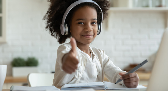 Young Girl with thumbs up