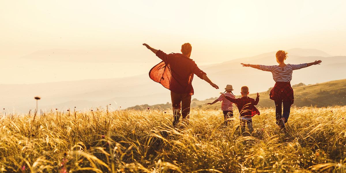 Family running through open field