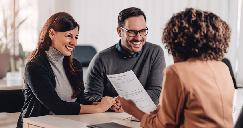 couple meeting with loan specialist