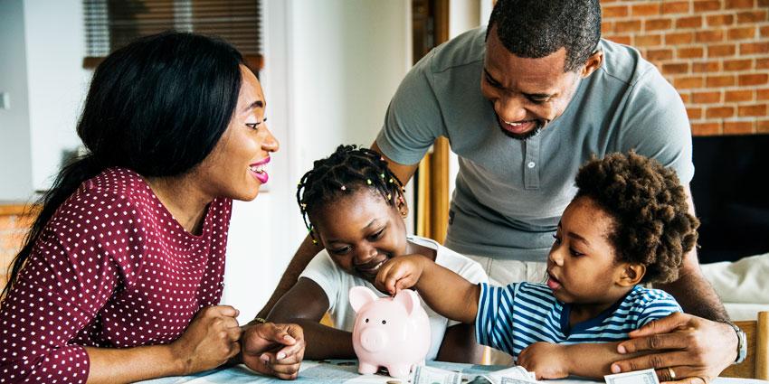 family adding to piggy bank