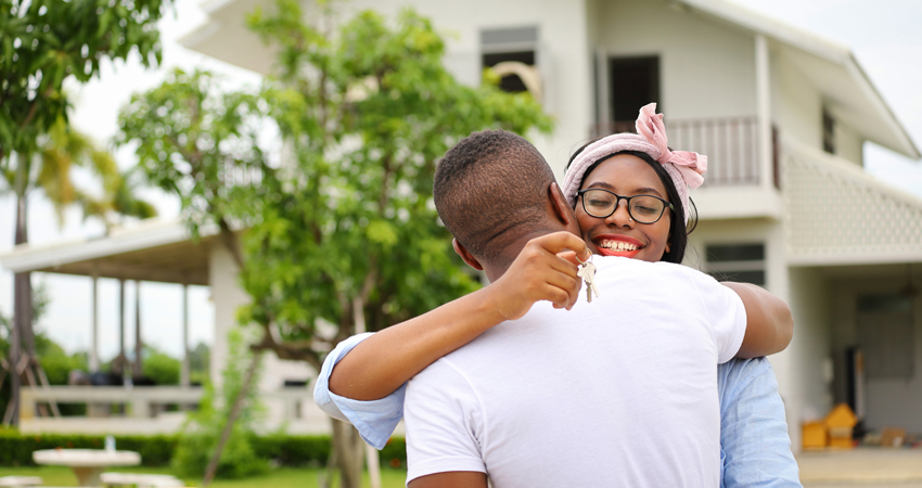 young happy couple holding keys